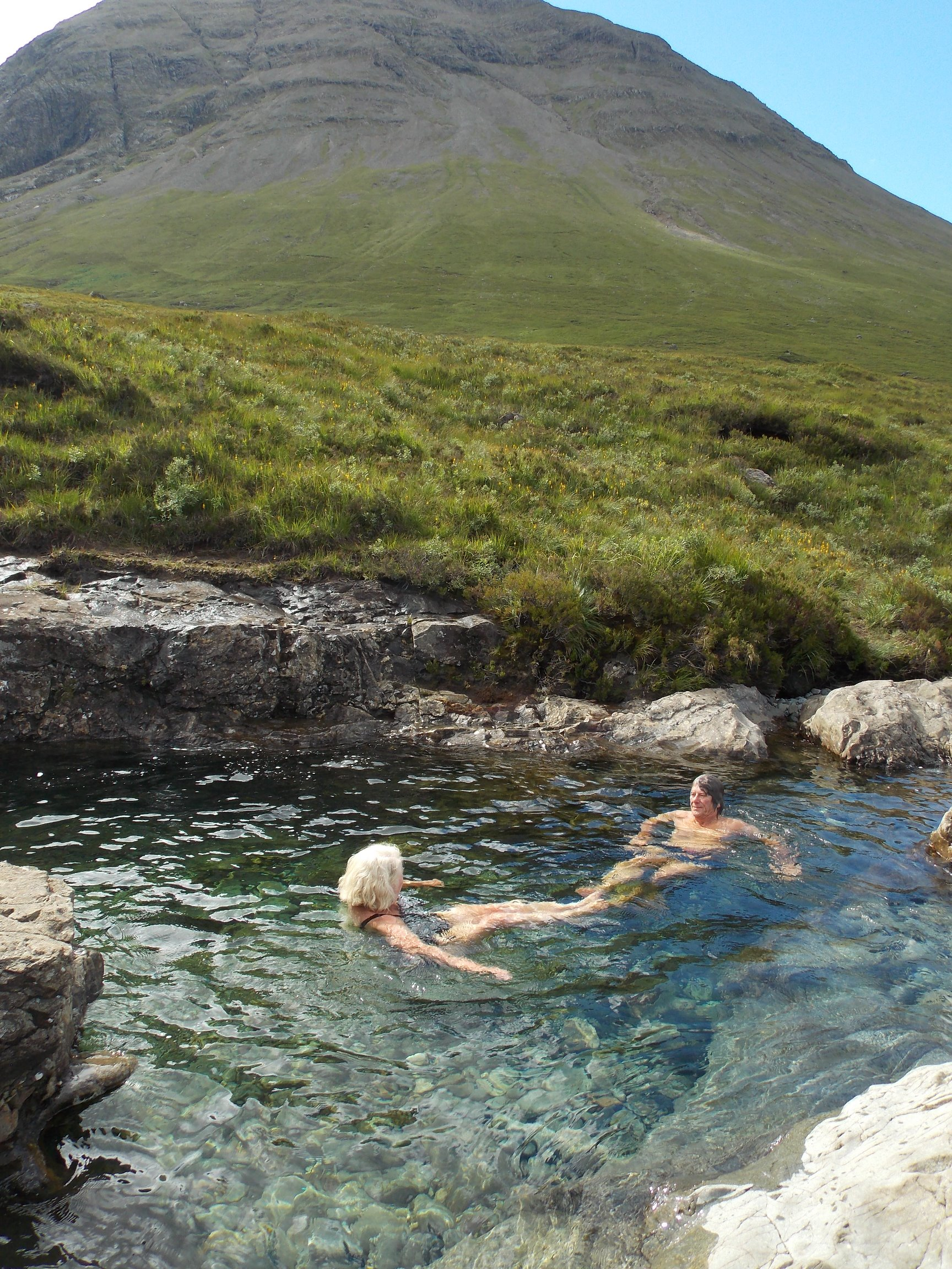 Relaxing in a fairy pool on the Isle of Skye