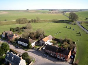 An aerial shot of the village of Avebury with some of the stones - taken from the camera mounted under the red balloon!